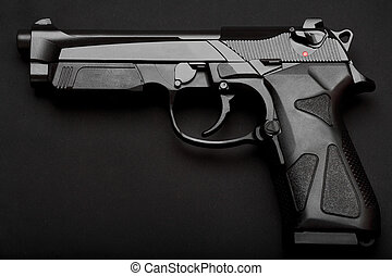 Pistol on black - Black semi-automatic pistol on a black ...