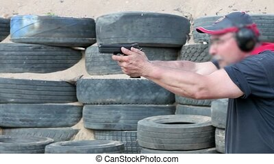 pistol shooting - Professional shooter firing from a handgun...