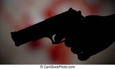 Pistol silhouette against bloody background crime concept