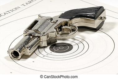 Pistol - Photo of a Pistol on a Target - Firearm