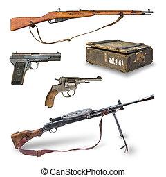 pistols, rifles, machine guns, ammunition box.