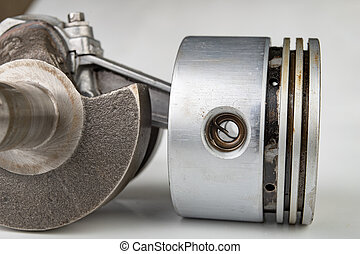 Piston and connecting rod of a small combustion engine....