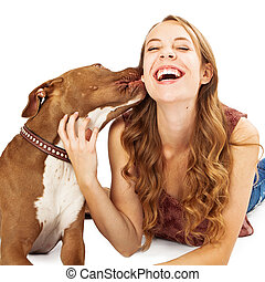 Pit Bull Kissing Teenage Girl - A friendly Pit Bull dog...