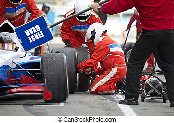 Pit crew during a pitstop - Teamwork and professionalism...