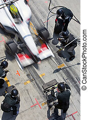 Pit crew in action - Professional pit crew ready for action ...