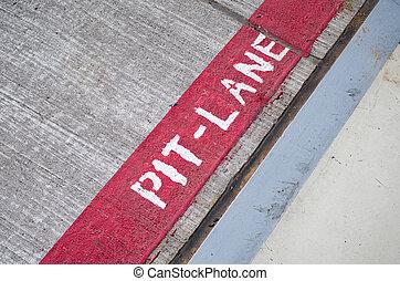 Pit lane markings on the asphalt