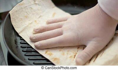 Pita bread in frying pan.