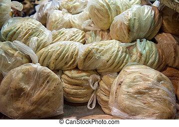 Pita bread in nylon bags in Jerusalem Old City market, Israel