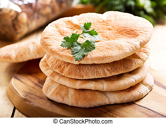 pita bread on wooden board