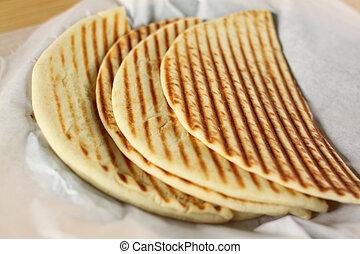 Pita Bread - Plate of grilled pita bread.