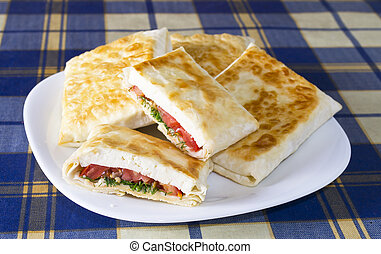 Pita bread with cheese, tomato and herbs