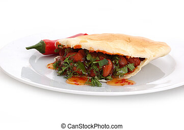 pita and red beans over white background