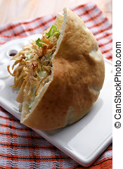 Pita with chicken meat