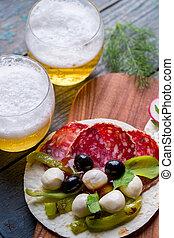 Pita with mozzarella and olives