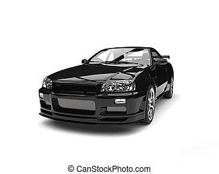 Pitch black urban sports car - studio shot