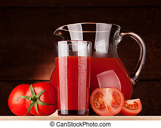 tomato juice - pitcher and glass of tomato juice