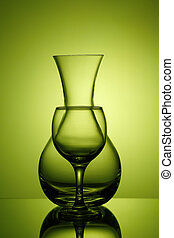 Pitcher and wine glass on green background, silhouette on ...