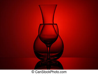 Pitcher and wine glass on red background, silhouette on the ...