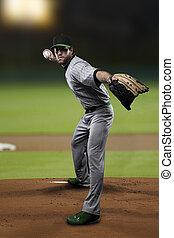 Pitcher Baseball Player on a Green Uniform on baseball ...