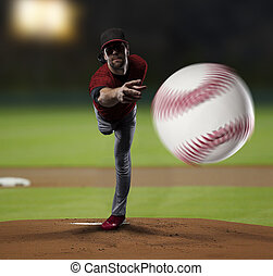 Pitcher Baseball Player with a red uniform on baseball ...