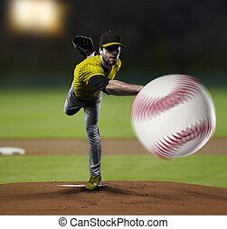 Pitcher Baseball Player with a yellow uniform on baseball ...
