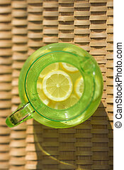 Pitcher of lemonade.