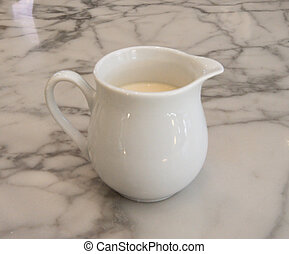 Pitcher of milk on marble table