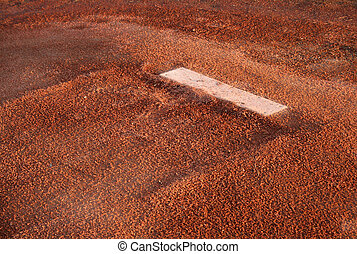 A closeup of the rubber on the pitchers mound.