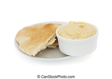 pitta bread and hummous isolated on a white background