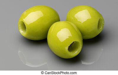 pitted olives on grey background