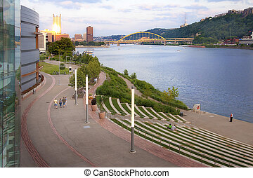 Pittsburgh Early Evening - Visitors walk along the Ohio...