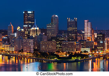 Image of Pittsburgh downtown skyline at night.