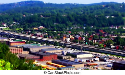 Pittsburgh tilt shift clip of highway and city view -...