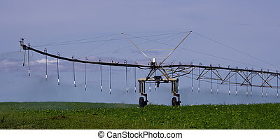 Pivot irrigation system in operation supplying water