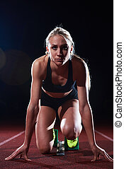 pixelated design of woman sprinter leaving starting blocks...