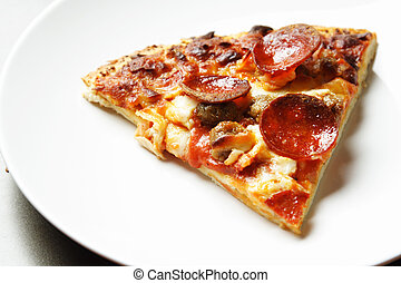 A slice of thin crust pepperoni and beef pizza on a plate