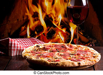 pizza and glass of wine - pizza with bacon, salami and glass...