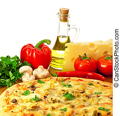 Pizza and ingredients with focus on pizza