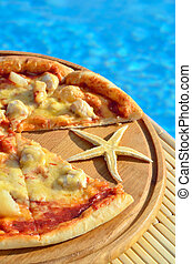Pizza and starfish in the pool background.