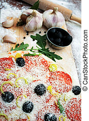 Pizza and the ingredients - Pizza, olives, garlic, rolling...