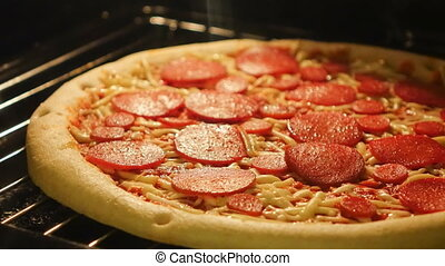Pizza baking in the oven Time-Lapse - A time-lapse video of...