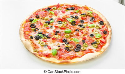 Pizza - Beautiful multi colored and crispy pizza with basil,...