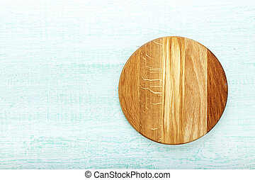 pizza board on wooden background