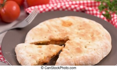 Pizza calzone on wooden background - Italian food, pizza...