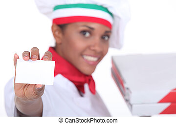 Pizza chef holding up a blank business card
