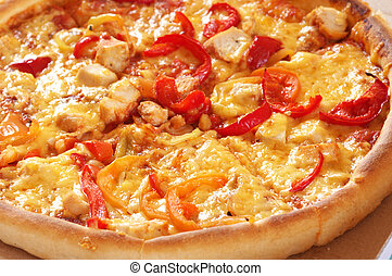 Close-up of pizza with cheese, pepper and chicken meat.