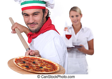 pizza cook and a waitress
