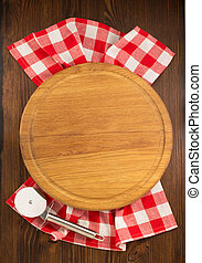 pizza cutting board on wooden background