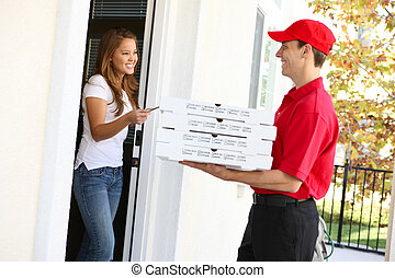 Pizza Delivery - A pizza delivery man giving order to pretty...