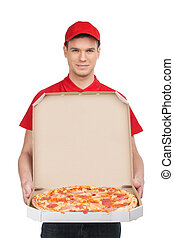 Pizza delivery. Cheerful young deliveryman holding a pizza...
